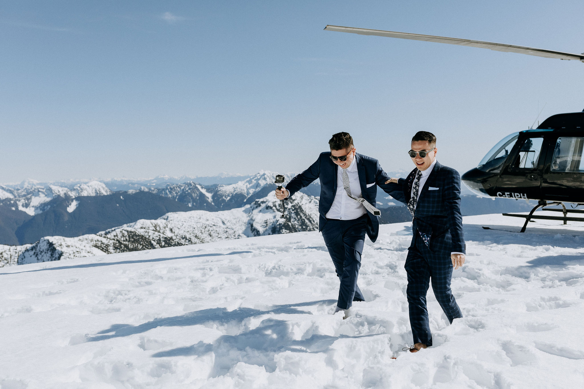 Couple in the snow at their helicopter elopement