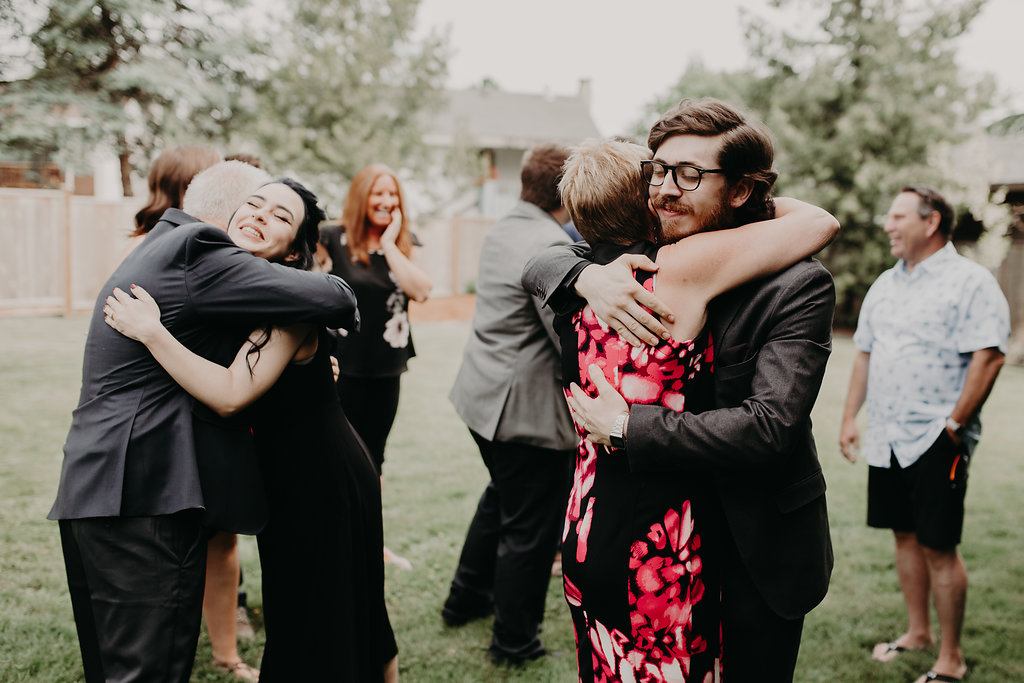 Newlyweds hugging their parents