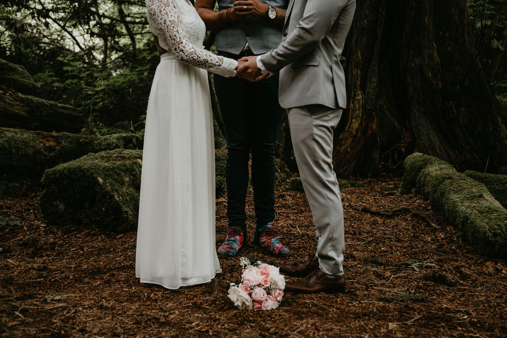 Couple holding hands at their ceremony - no wedding regrets here!