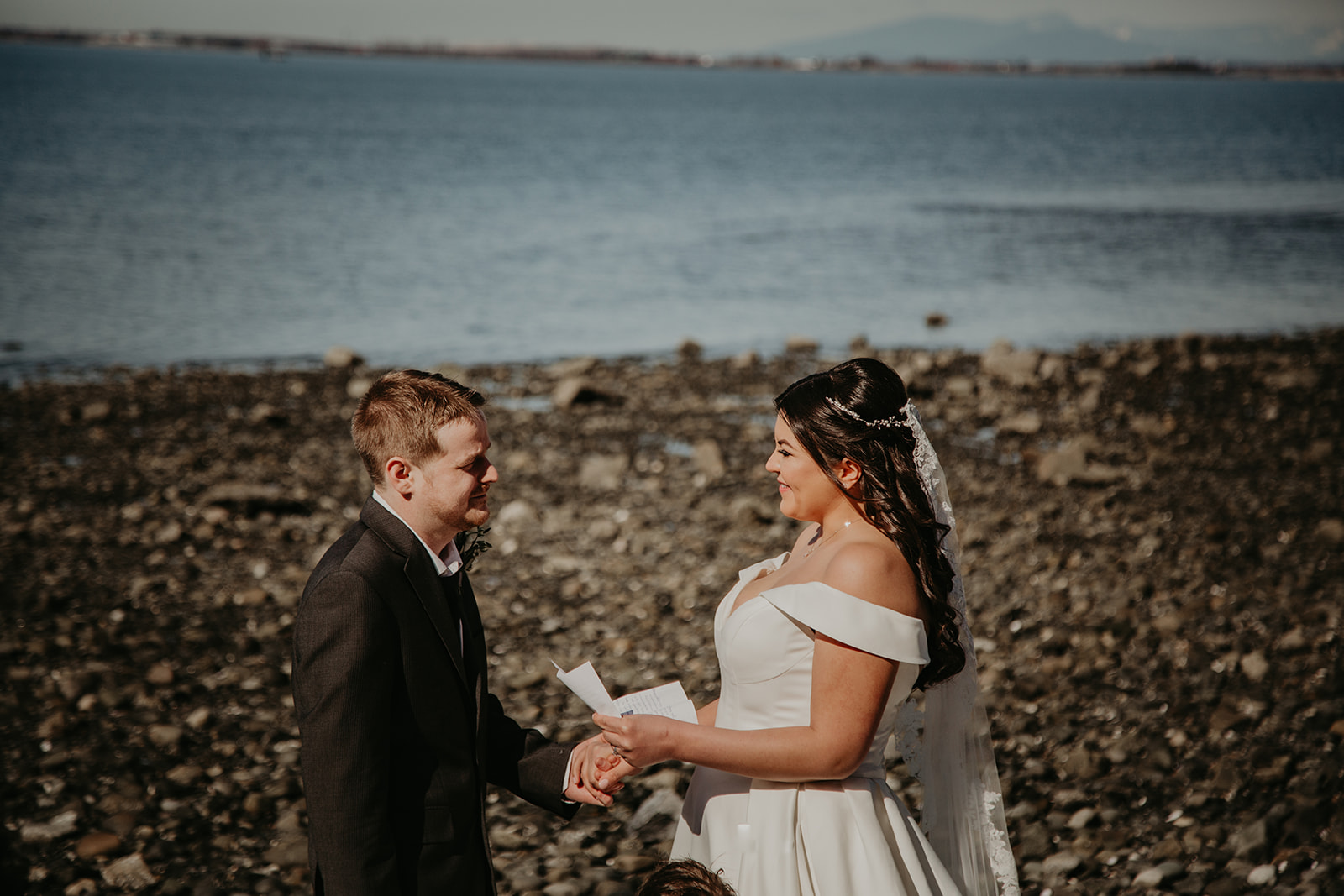 couple exchanging traditional wedding vows on the beach