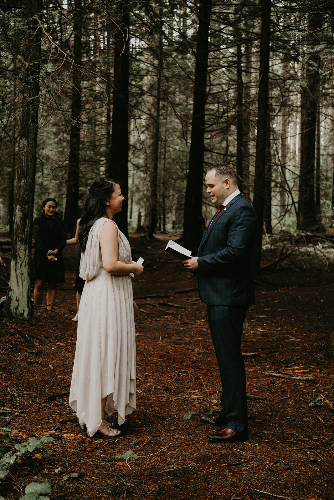 couple exchanging vows in the forest in Vancouver