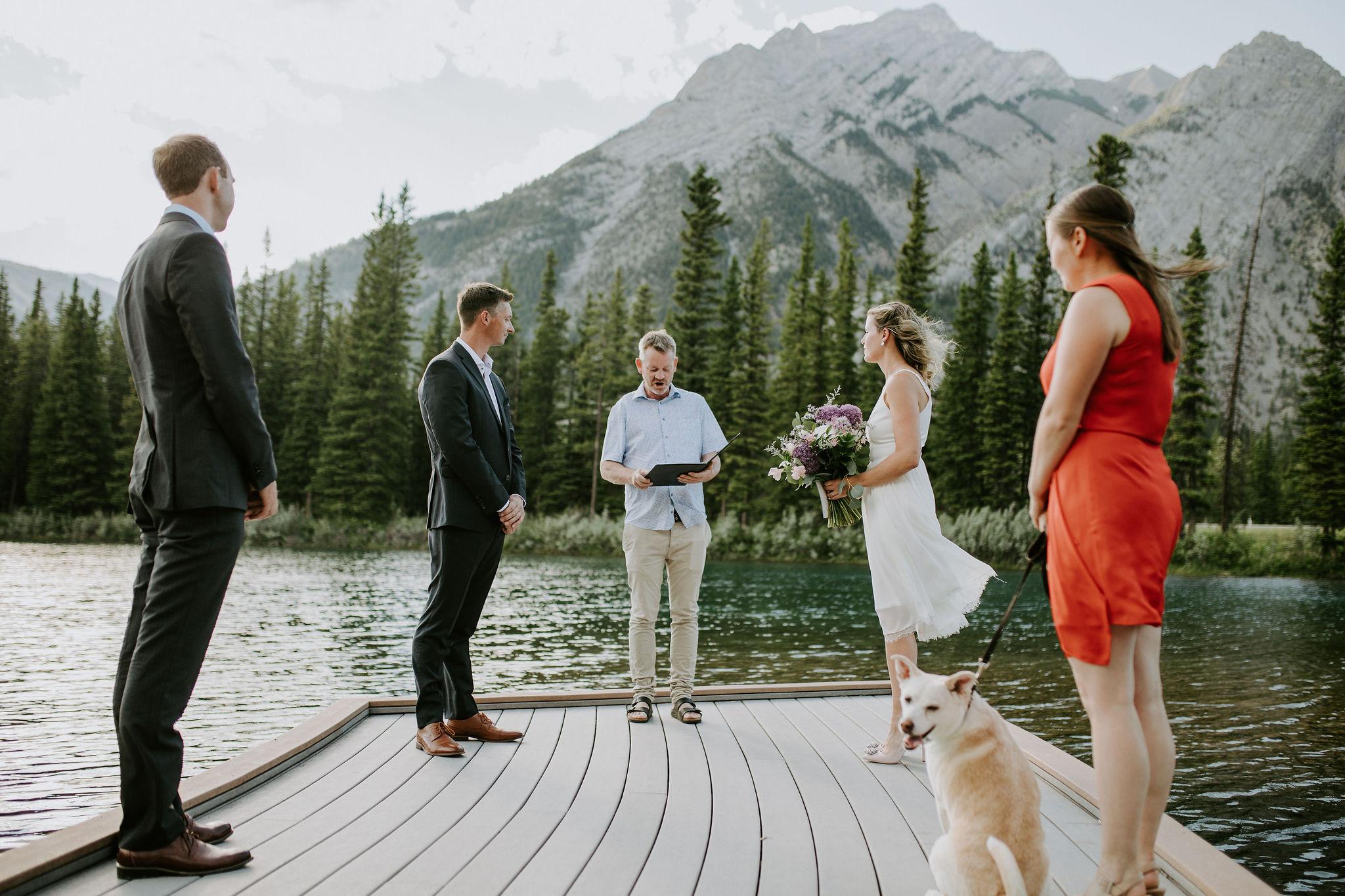Elopement on a dock at Lake Minnewanka, Banff